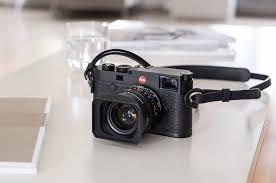 Фотокамеры и объективы Leica